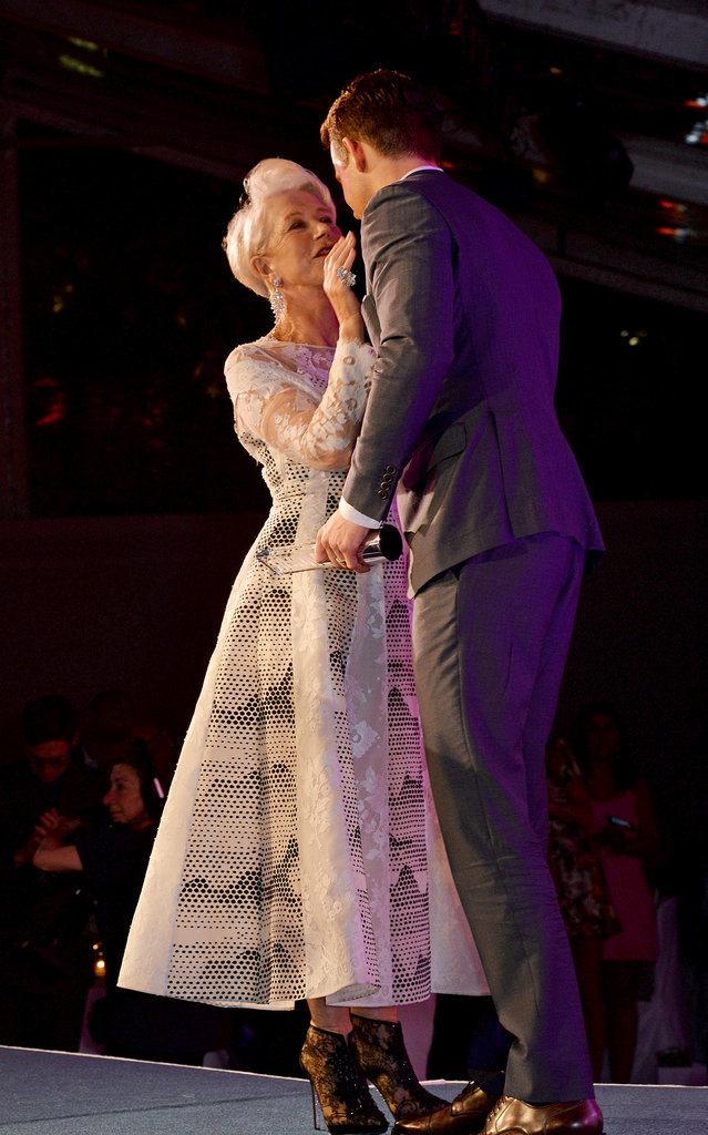 Helen Mirren got close to Ryan Reynolds while accepting her award at Glamour's Women of the Year Awards in London on Wednesday.