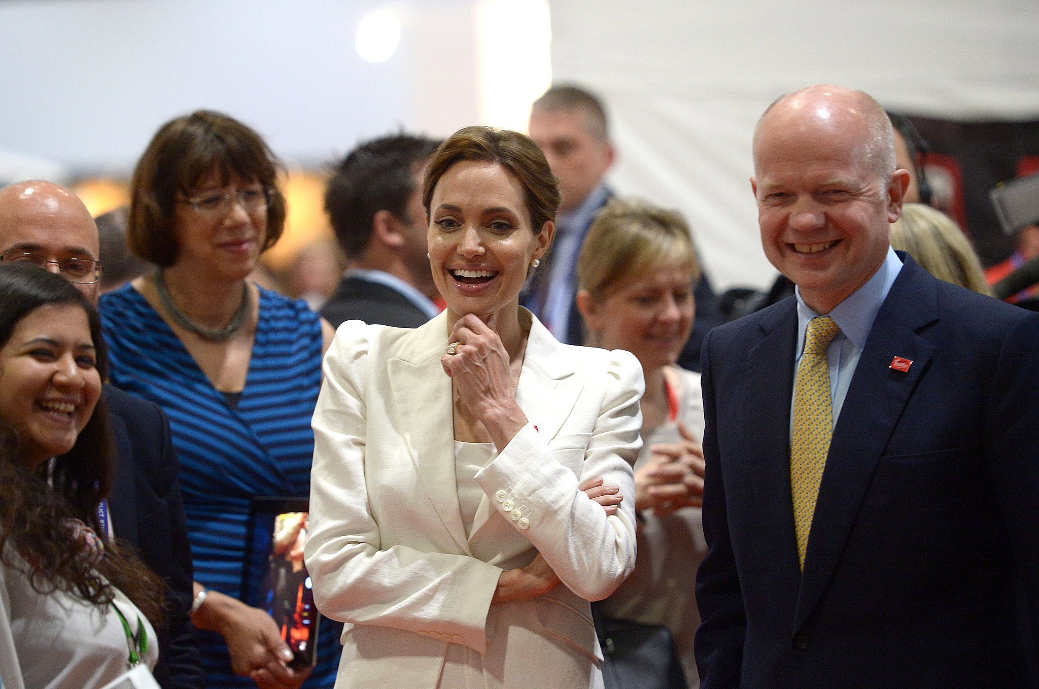 Angelina walked with William Hague to visit with attendees and speakers at the summit on Wednesday.
