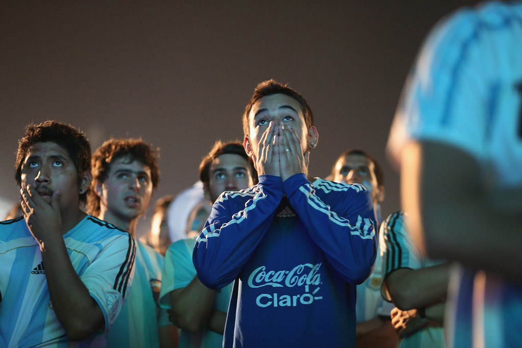 Argentina fans brought their hands to their faces as they watched the final minutes of the game against Bosnia.