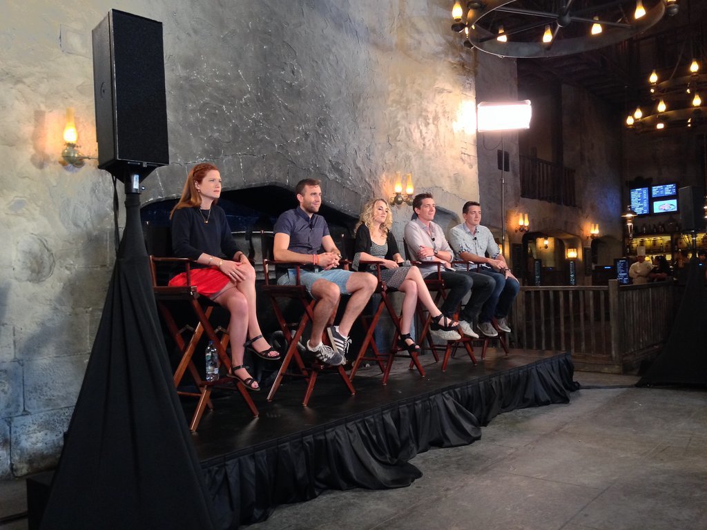 Bonnie Wright, Matt Lewis, Evanna Lynch, James Phelps, and Oliver Phelps sat together for a panel in The Leaky Cauldron restaurant.