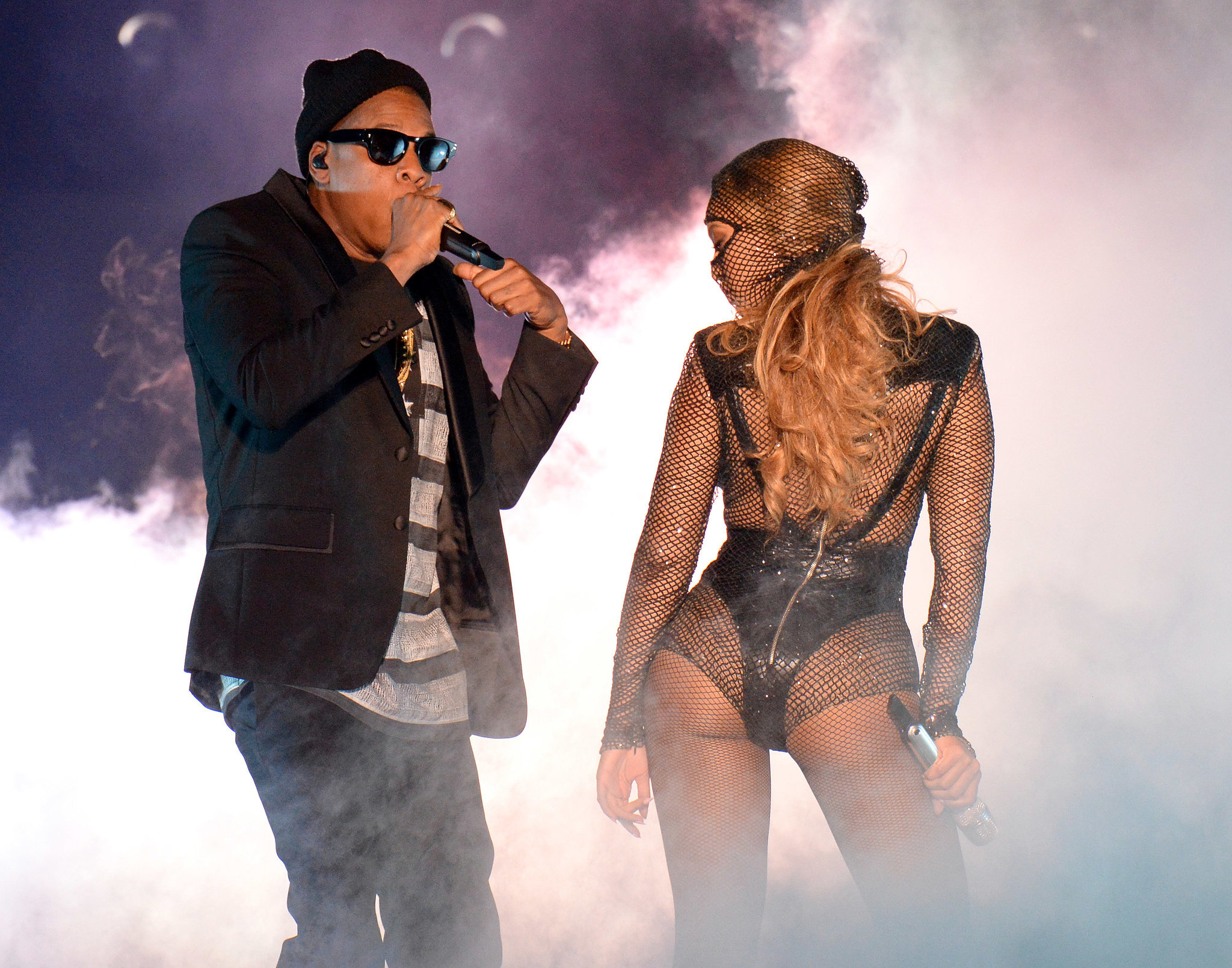 """Source: Getty / Kevin Mazur  June 25: After lying low for a couple weeks, Jay Z and Beyoncé kicked off their On the Run tour in Miami. The couple gave the crowd exactly what they hoped for, showing off lots of hot PDA while performing over 40 of their megahits, as well as footage of their April 2008 wedding during a performance of the song """"Forever Young."""" June 27: The couple released a video showing all the intense backstage prep that went into their tour. In it, we also get a glimpse of the couple's sweet PDA — holding hands, hugging, and shooting each other loving glances — before their 2-year-old daughter, Blue Ivy, tells them """"Good job!"""" after wrapping their debut concert. June 28: Rumors of trouble in paradise started after their Cincinnati stop, when Beyoncé altered the lyrics to her 2006 song """"Resentment"""" during the show. Although she has a history of changing the wording, this particular version features the lyrics """"I gotta look at her in her eyes and see she's had half of me / She ain't even half of me / That b*tch will never be."""" The song is clearly about a woman who takes back her cheating lover."""