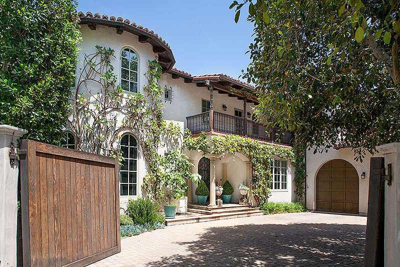 The gated entrance to the home offers plenty of privacy for the double lot.  Source: David Offer Fine Homes