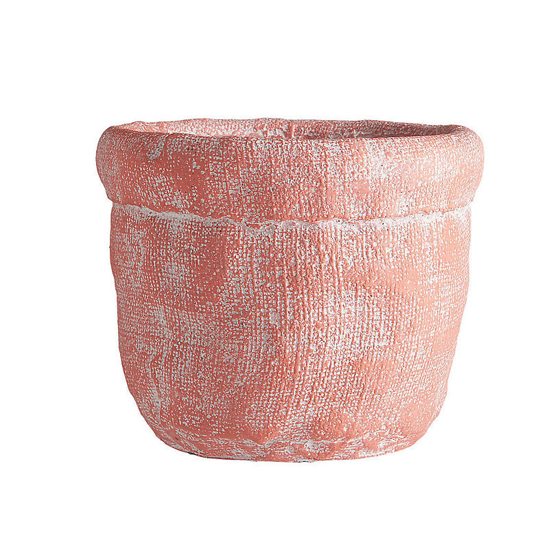 What looks like a burlap sack is actually a cement vase ($4) in the prettiest shade of coral. Try potting it with succulents for a long-lasting focal point.  — AE