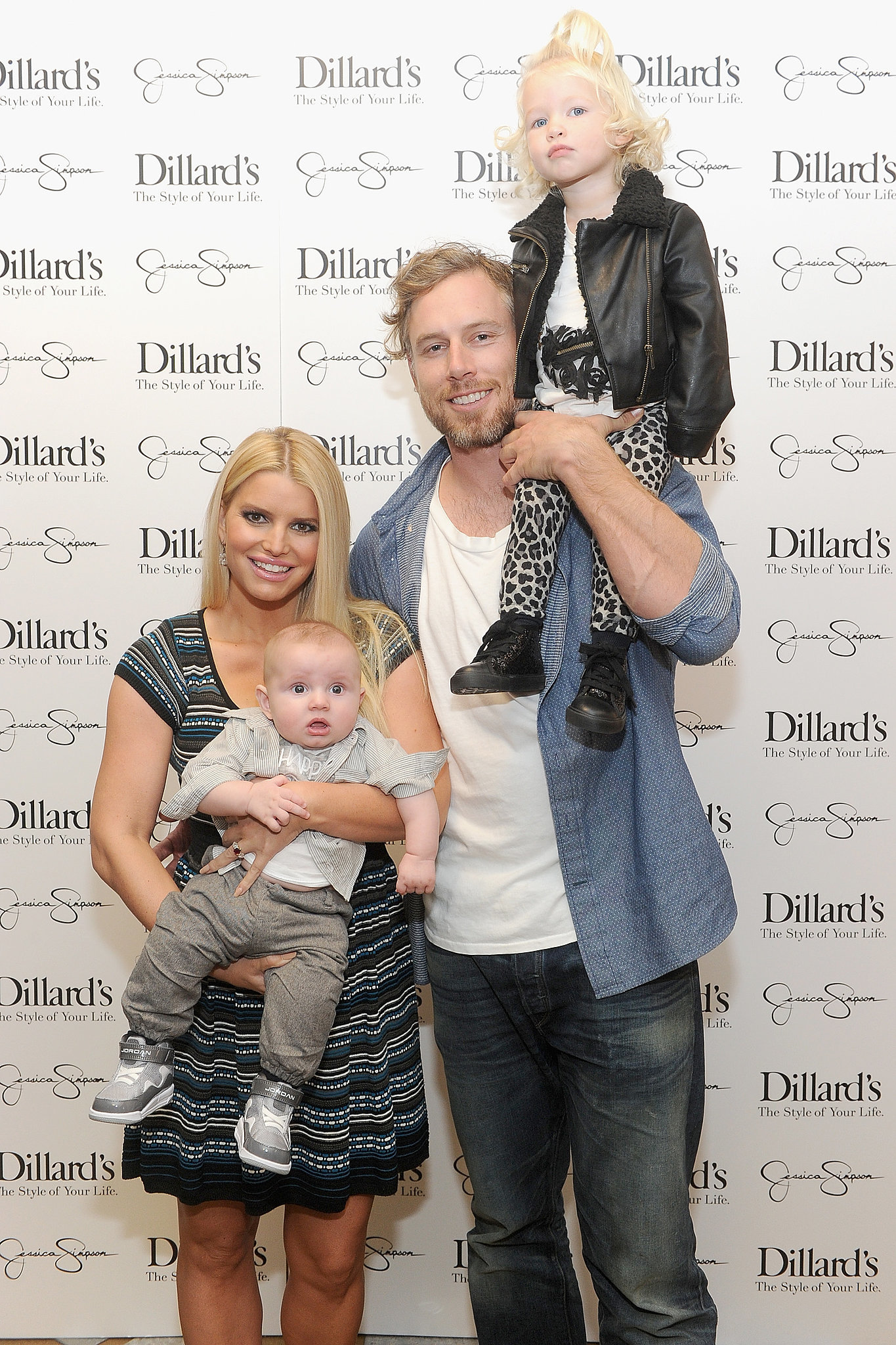 Jessica, Eric, and their kids, Maxwell and Ace, were all smiles at an event for the Jessica Simpson Collection in Dallas in November 2013.
