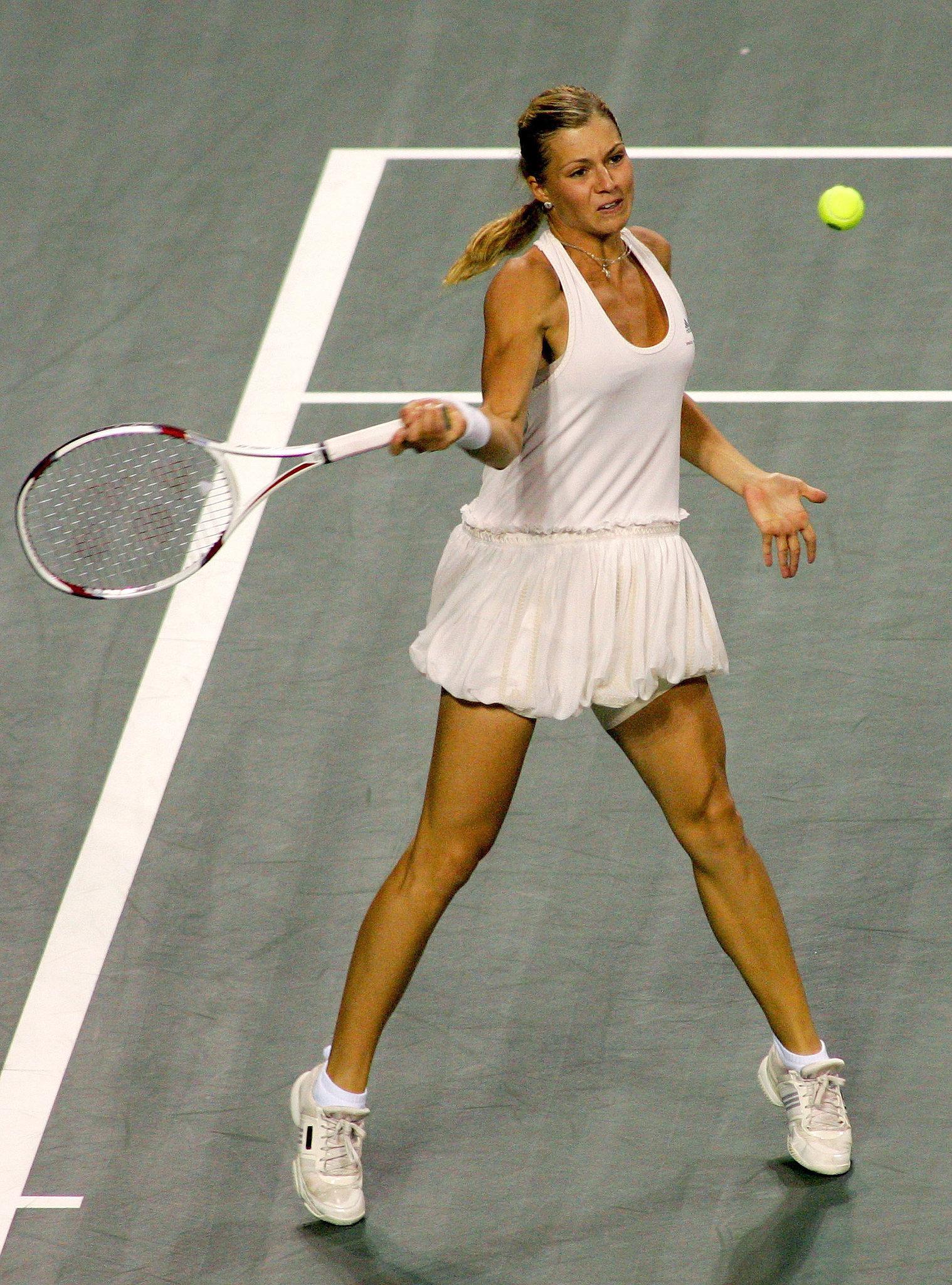 Tennis babe Maria Kirilenko brought fashion to the tennis court in her tutu-inspired dress.