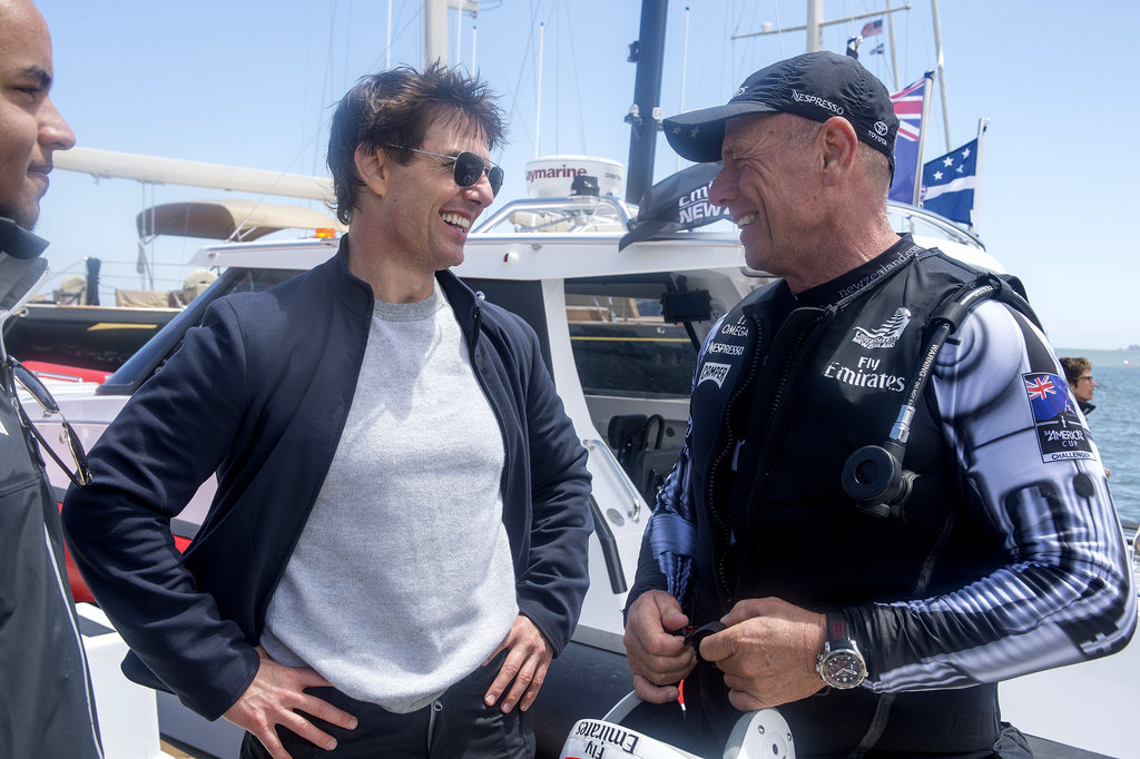 Tom inadvertently showed off a signature pose while chatting with a member of Emirates Team New Zealand before he set sail in San Francisco.