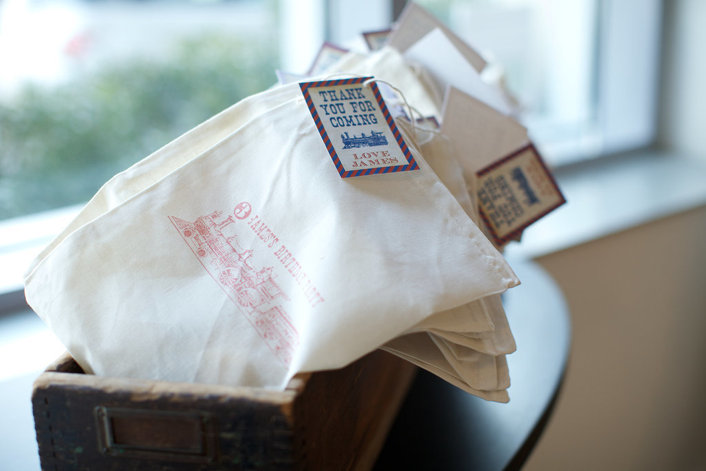 The favors were presented in organic cotton bags with a train motif. Source:  Clay Williams and Alex Nirenberg for Keren Precel Events