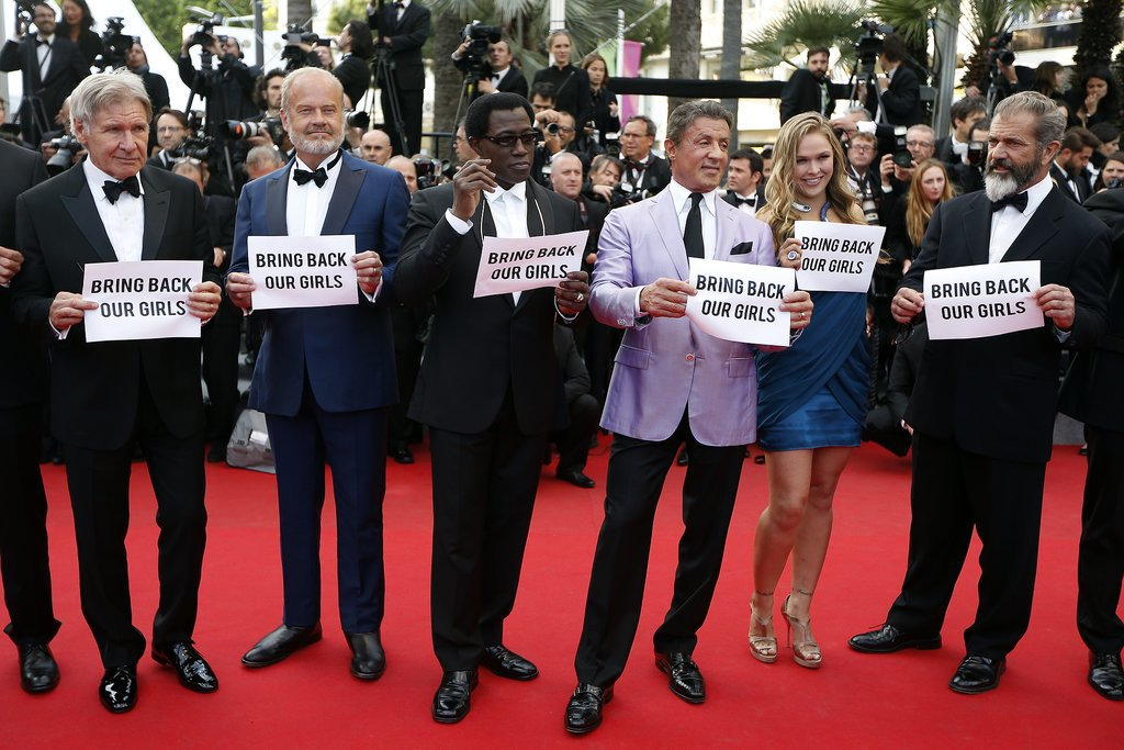 The cast of The Expendables held up signs during the Cannes Film Festival on May 18.