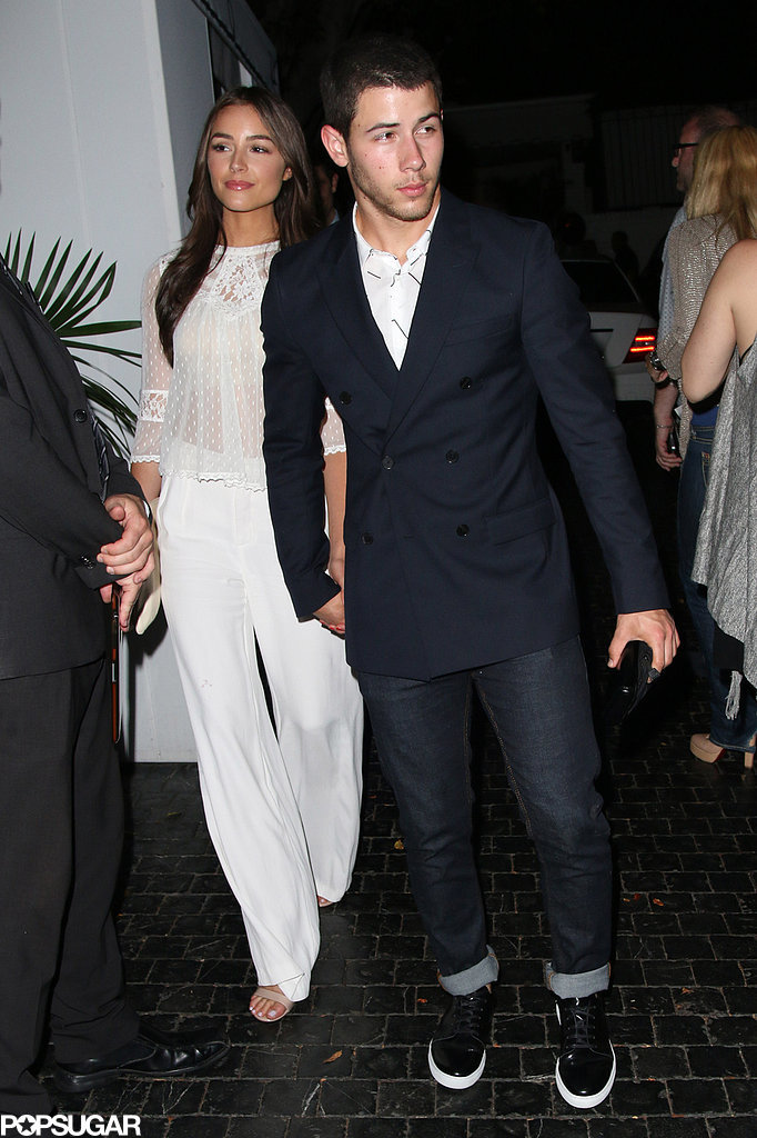On Saturday, Nick Jonas guided the way for his girlfriend Olivia Culpo after attending his mom's birthday celebration at the Chateau Marmont in LA.