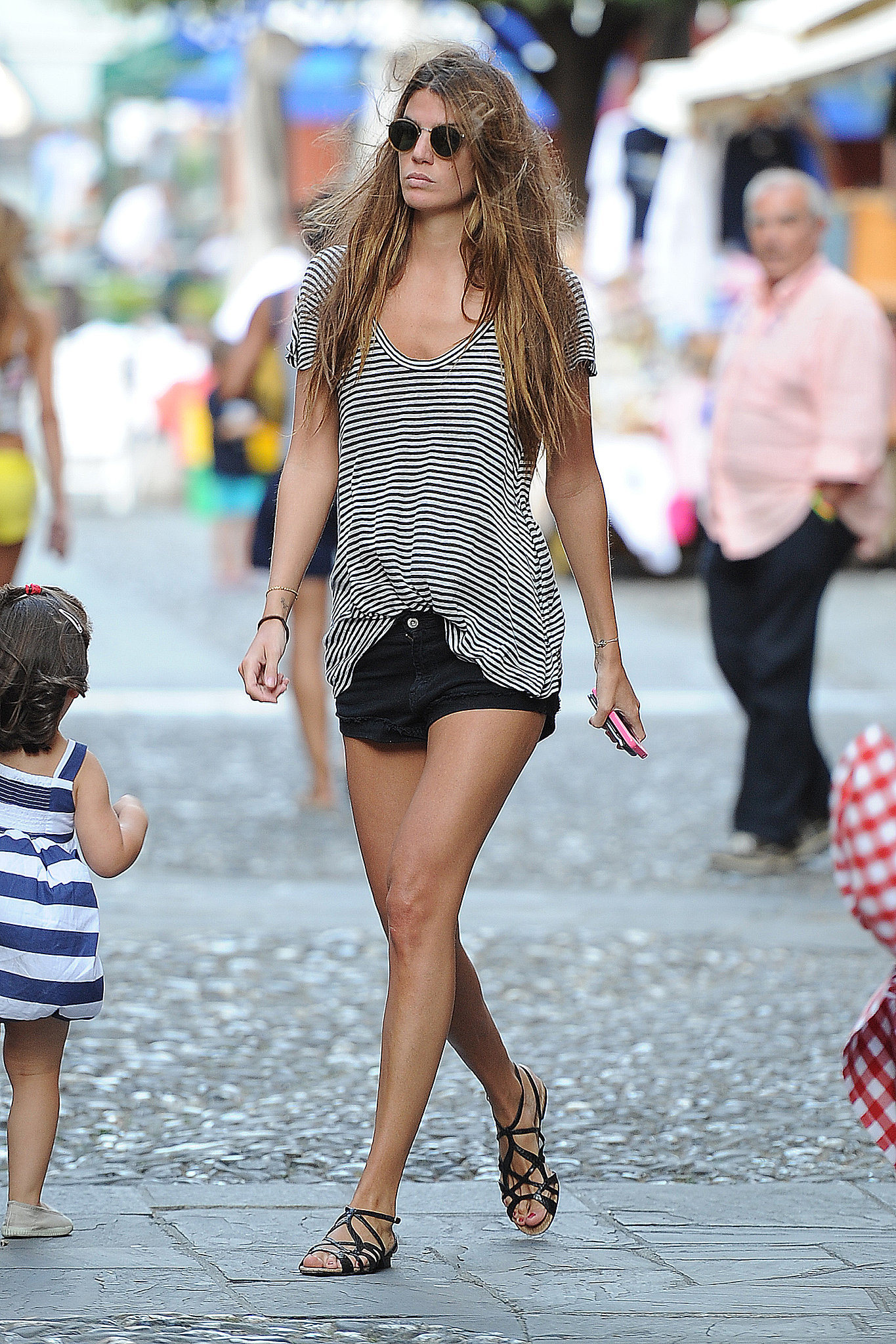 Bianca Brandolini D'Adda was the picture of Summer in cutoffs, strappy (walkable) flats and a striped tee while hanging in Italy.