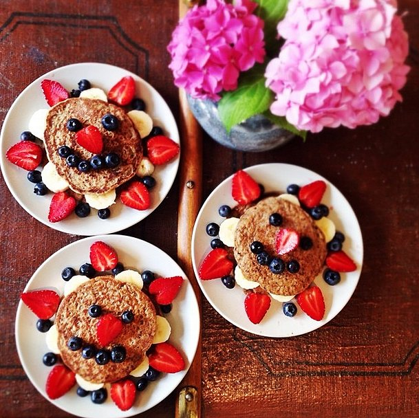 Add chia seeds to your pancakes for added protein and fiber that will help you feel full. Then top your cakes with a smiley face! Source: Instagram user jellow_