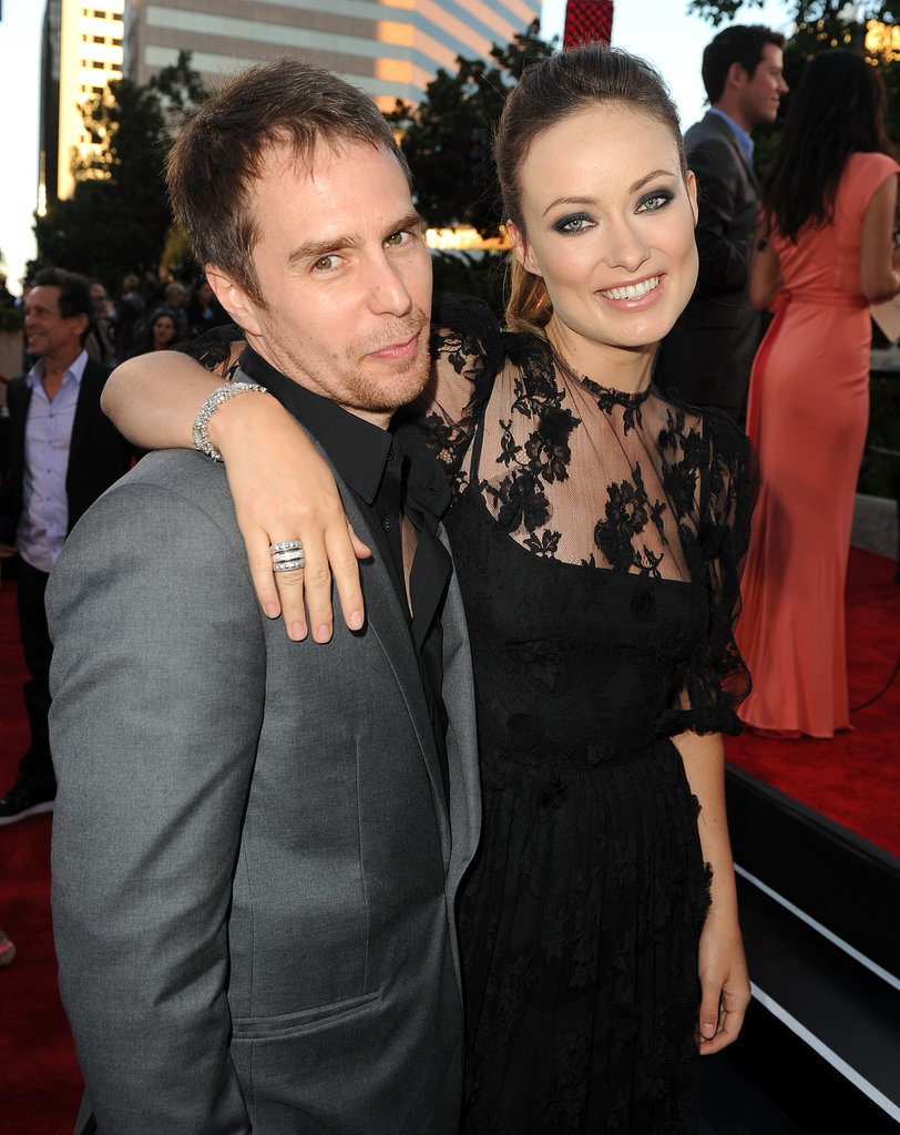 Olivia Wilde kept her arm around Sam Rockwell at the premiere of Cowboys & Aliens in 2011.