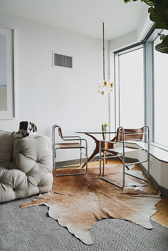 What is your favorite budget-friendly piece in your home? Why? Probably the rope chairs that I found on Etsy ($450 for the pair). They were actually the first thing I bought. The size and style were what I was looking for, and I started to blend other pieces around those two chairs. Source: Homepolish via The Everygirl