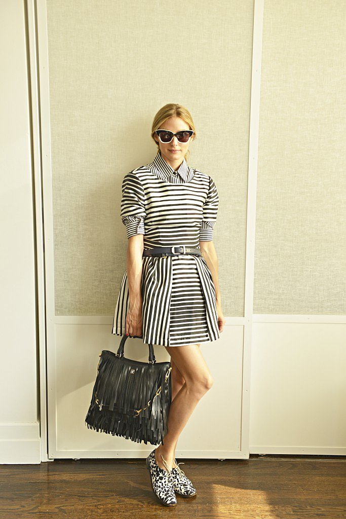 """Sure, a sleeveless striped dress could be an outfit all on its own, but Olivia added some serious mileage to the look with a striped button-down layered underneath plus a pair of printed Tibi oxfords for another pop of fresh print. While the dress on its own might have been perfect for a weekend, this smart style has """"office hours"""" written all over it.  Source: Olivia Palermo"""