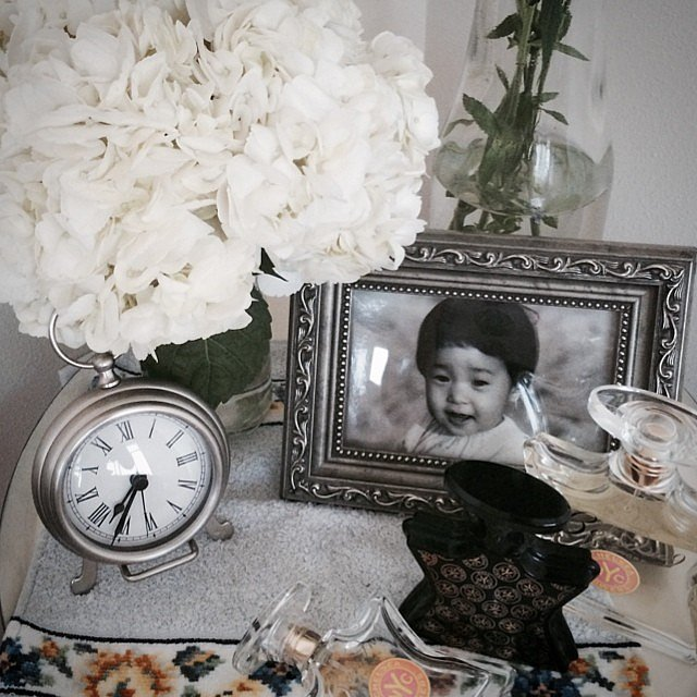 Clutter can be cute, if done stylishly. You don't have to sacrifice photos, flowers, and clocks if they go well together! Keep everything within the same color range, then accumulate away.