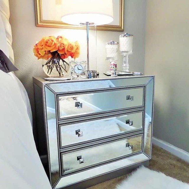 If you have a tiny bedroom, you can enlarge the space by finding a mirrored bedside table. An adaptable piece like this can be modern, glam, boho, or anything in between!