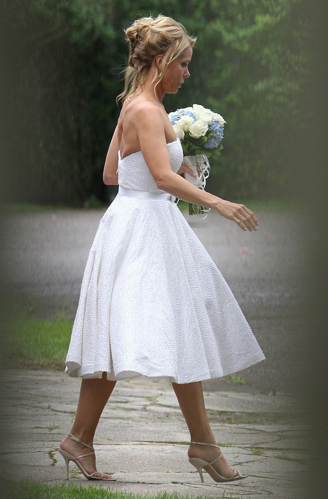 Cheryl wore her hair up and donned a strapless white gown for her and Robert's nuptials.