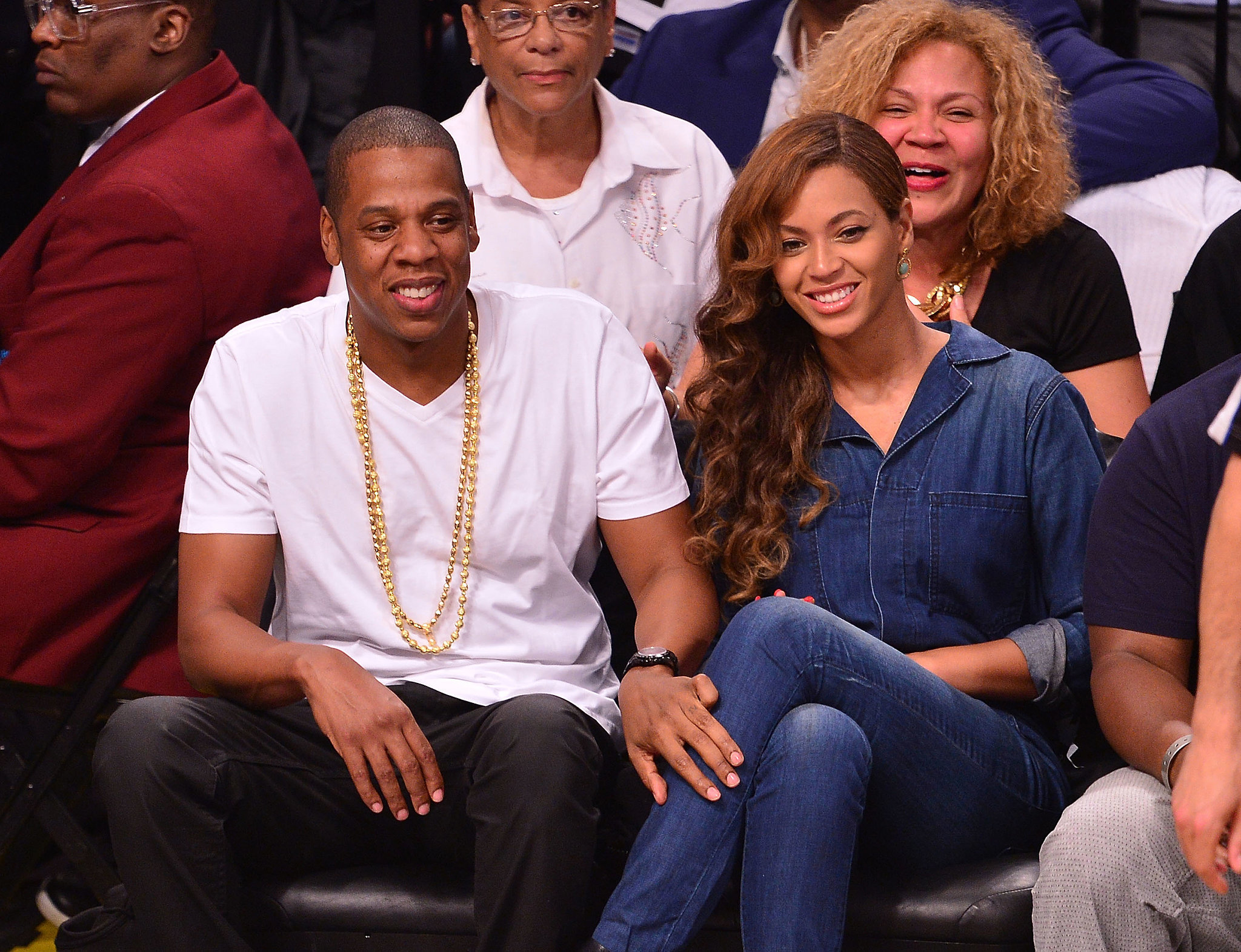 "Source: Getty / James Devaney  May 12: Despite all the hoopla about the elevator fight (including speculation as to what caused the attack), Beyoncé and Jay Z appeared completely unfazed as they sat courtside for a Brooklyn Nets game. Reports surfaced that Beyoncé got her wedding tattoo, the Roman numerals ""IV,"" removed from her ring finger.  May 14: Without saying a word, Beyoncé gave a subtle response to all the drama by sharing a series of sweet throwback photos of her and Solange on Instagram. May 15: Jay Z and Beyoncé finally addressed the incident in a joint statement given to the Associated Press and let the public know that they've moved on: ""At the end of the day families have problems and we're no different. We love each other and above all we are family. We've put this behind us and hope everyone else will do the same."""