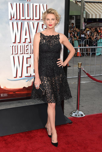 Never one to shy away from showing a hint of skin, Charlize paired her sheer Dior number with Christian Louboutin slingback pumps and a box-clutch.