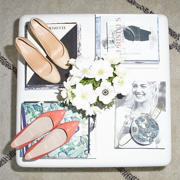 Don't banish clothes and shoes to your closet. Show off your favorite style pieces on your coffee table. Source: Instagram user thecoveteur