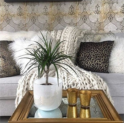 Are you stuck trying to style a tiny living space? A mirrored tabletop will help make the room feel bigger. Source: Instagram user cushandcoosh
