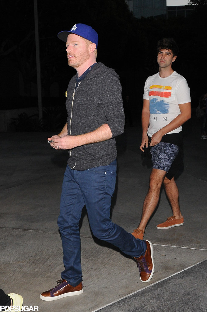 Jesse Tyler Ferguson and his husband, Justin Mikita, were dressed casually.