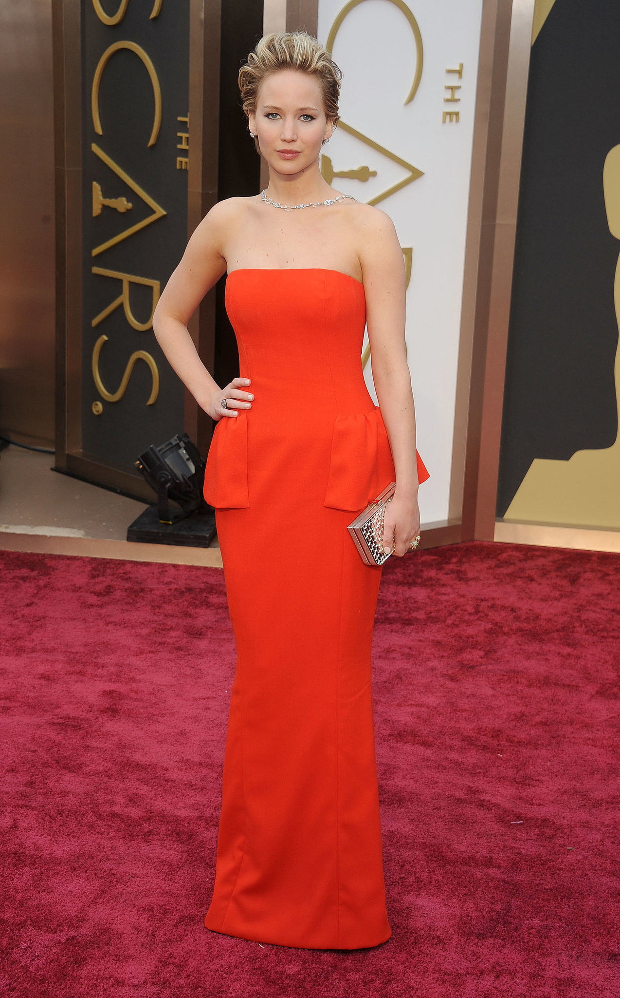 "While we love how polished Jennifer looked in this peplum Dior gown at the 2014 Oscars, our favorite element was her diamond Neil Lane ""backlace."""