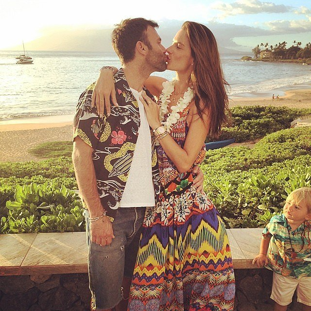 "Alessandra embraced and kissed husband Jamie as son Noah looked on. ""It looks like someone is waiting for his turn,"" she joked in the caption.  Source: Instagram user alessandraambrosio"