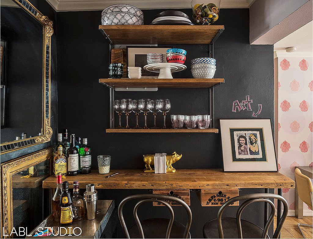 PS: Tell us how you came up with the concept for the chalkboard bar area. What are some of your favorite DIY moments in that area? LS: Since having a space to entertain was one of her wish list items, we took advantage of her huge wine collection and wine refrigerator. We decided that her large-by-NYC-standards foyer was the perfect nook to create a wine bar. We wanted to capture a cozy, Parisian cafe vibe and decided it was the perfect place for some chalkboard (another wish list request!). The dark color of the chalkboard paint helped to disguise the wine refrigerator, but we also commissioned a custom bar made from reclaimed wood and added to her existing mirror collection to further distract the eye.
