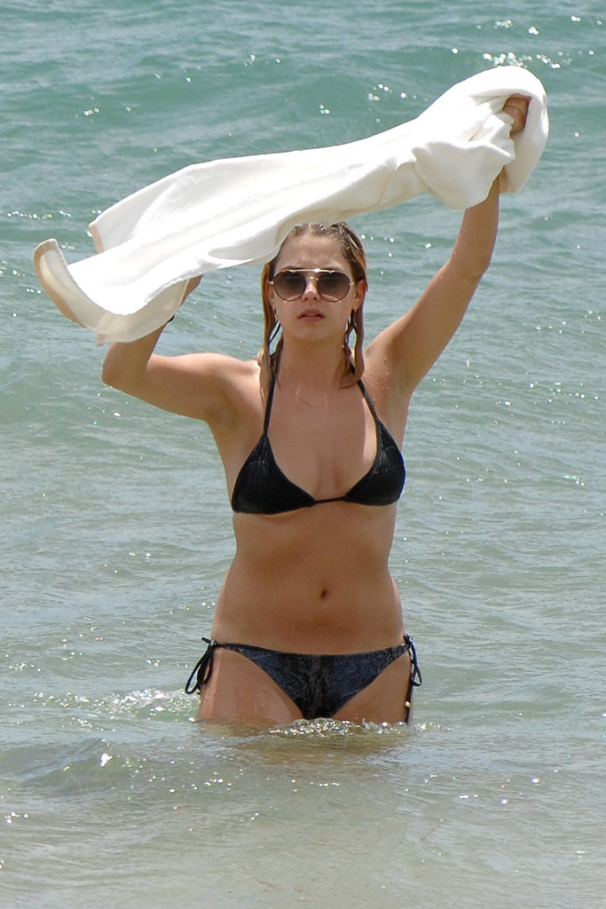 Ashley Benson wore a dark bikini in Maui in June 2014.