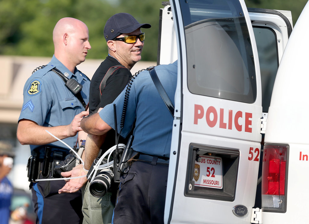 A Getty Images photographer was arrested for covering the demonstrations.