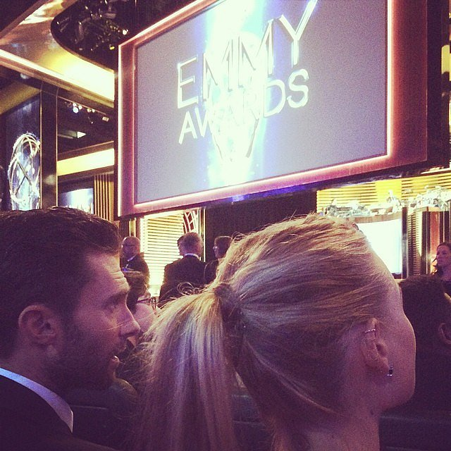 """""""Darn newlyweds in front of us won't stop making out...#emmys #thevoice #getaroom,"""" Carson Daly captioned this picture of Adam Levine and his wife, Behati Prinsloo."""
