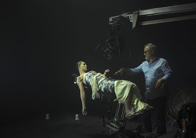 This behind-the-scenes shot shows director Fincher tending to Pike as Amy.