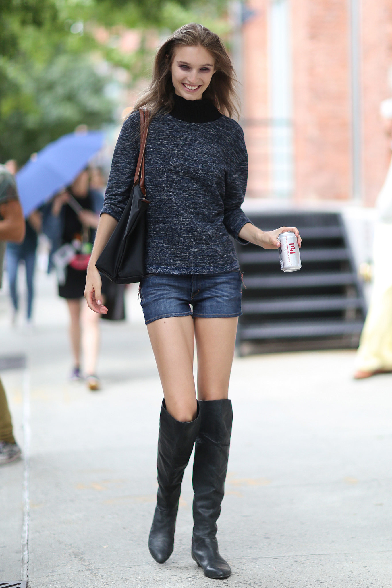 Denim shorts paired with over the knee boots is the only for Where do models live in nyc