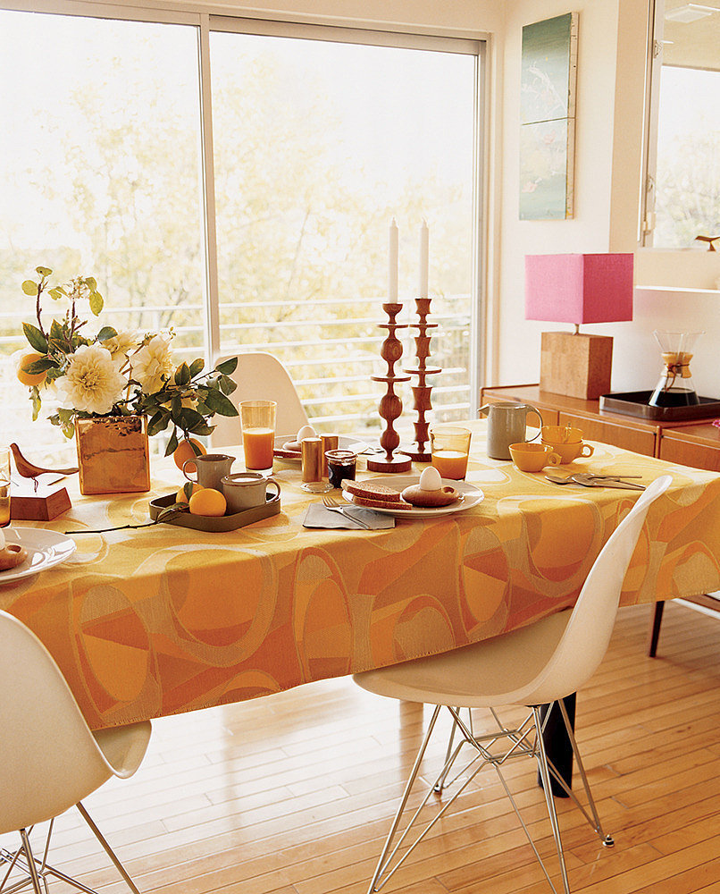 adding a caramel orange tablecloth in the dining room is an effortless