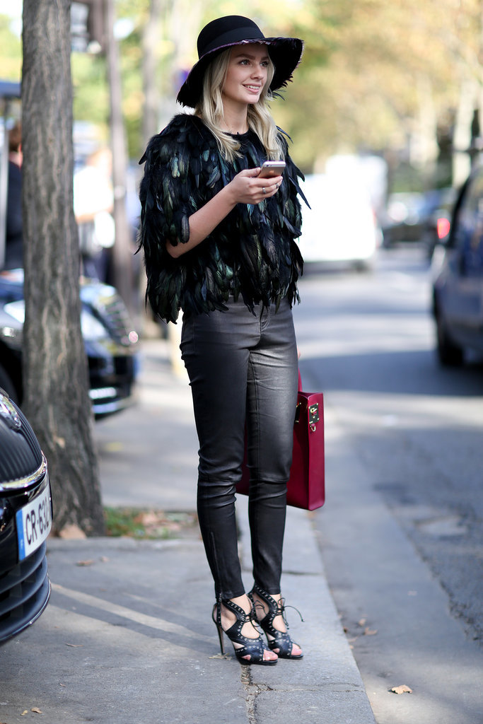 With feathers and a fedora, leather feels entirely rocker ...