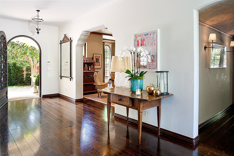 The foyer is bright and airy with large arched entryways into each room. Source: David Offer Fine Homes