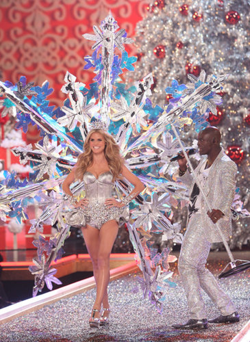 Heidi Klum nearly knocked husband and performer Seal over while she walked in the runway wearing giant snowflake wings during the 2007 show.