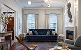 A Dark & Stormy Eclectic Living Room with Artistic Touches