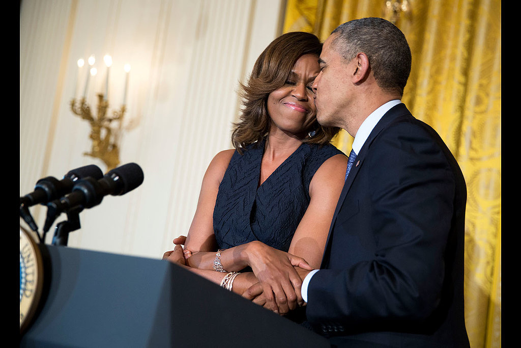 President Obama kissed First Lady Michelle Obama when she spoke at an Affordable Care Act reception in May.