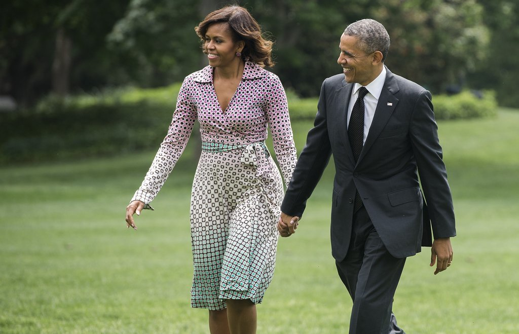 The couple held hands when they returned home after a trip to NYC in May.