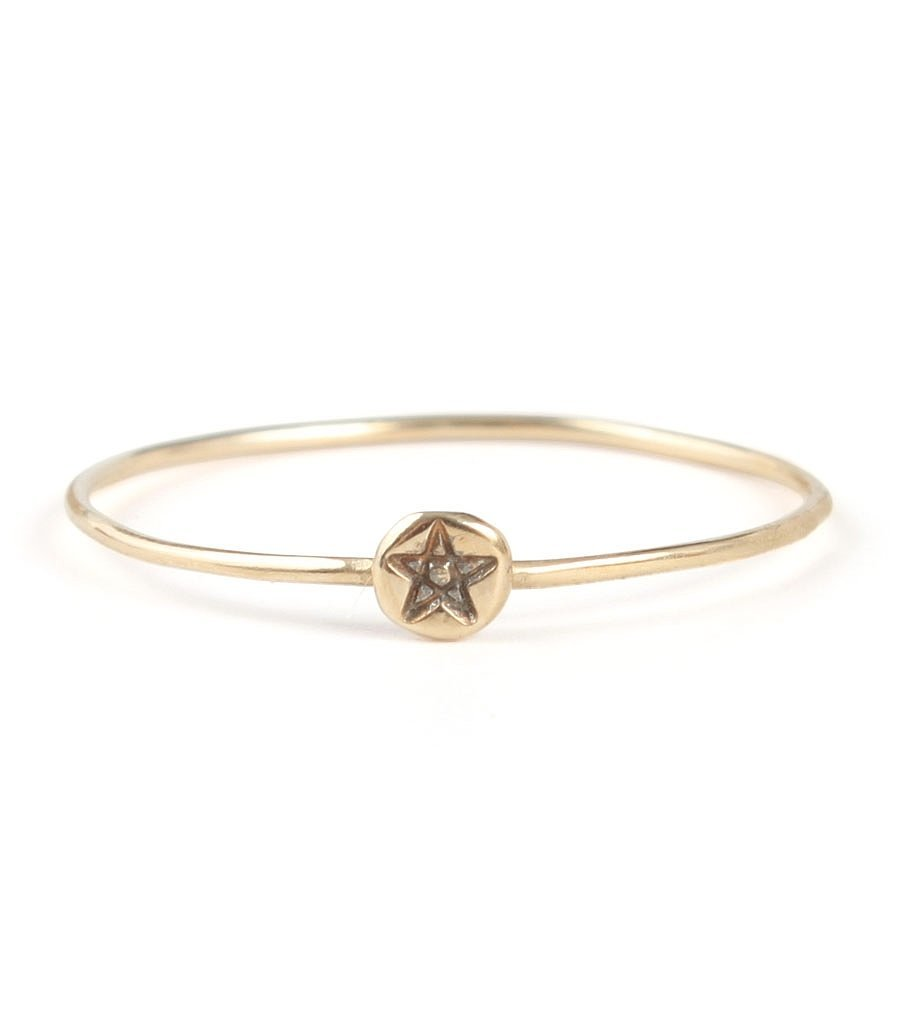 An understated ring will match any outfit, and this Bittersweets NY Pentagram Ring ($125) is the perfect amount of fun.