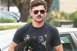 Zac Efron And His New Mustache Hold The Luckiest Dog In The World