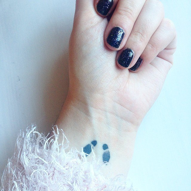 Footprints  44 Real Girl Tiny Tattoo Ideas For Your First Ink