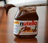 Watch the World's Cutest Nutella Thief Eat Her Loot Straight From the Jar