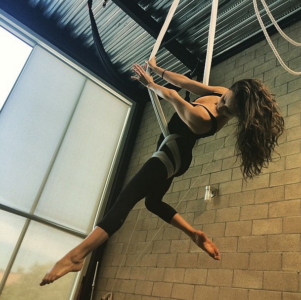 Pretty Little Liars actress Troian Bellisario does acrobatic exercises to keep healthy.