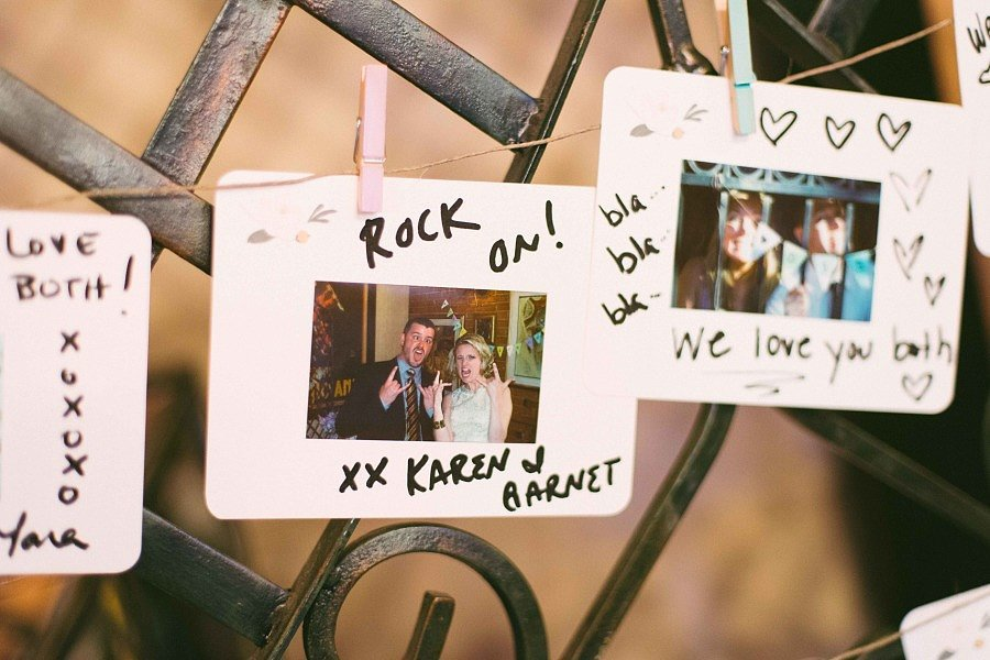 The Polaroids were then strung up. Instant DIY decor. Source: Olive Photography via Style Me Pretty