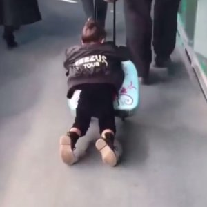 Video of North West Sliding on Her Frozen Suitcase