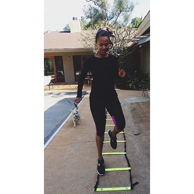 The busy mom of twins, Zoe Saldana made time for a morning workout, with her dog Mugsy cheering her on.