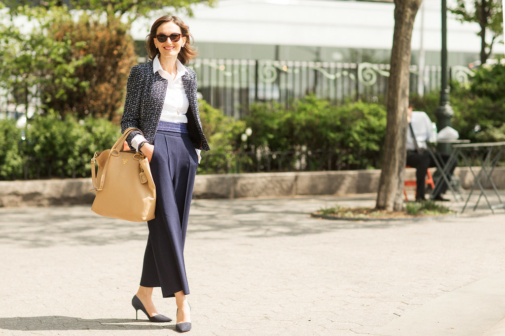Light wide-legged pants paired with an always-chic white button down are an office-ready combination you can wear over and over again.
